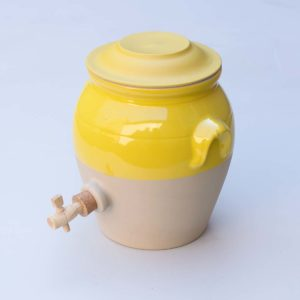 yellow glazed ceramic vinegar pot
