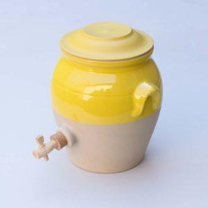 yellow glazed ceramic vinegar pot