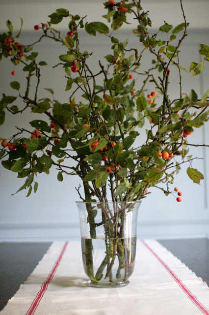 crab apple branches in a vase as table decoration - pascale store seasonal design ideas
