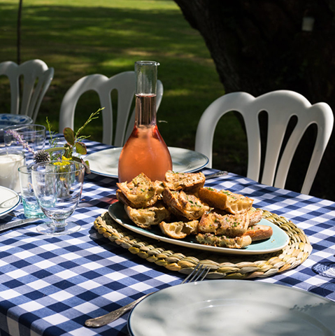 This Month - Pascale's blog - a carafe of wine sits on a sunny table